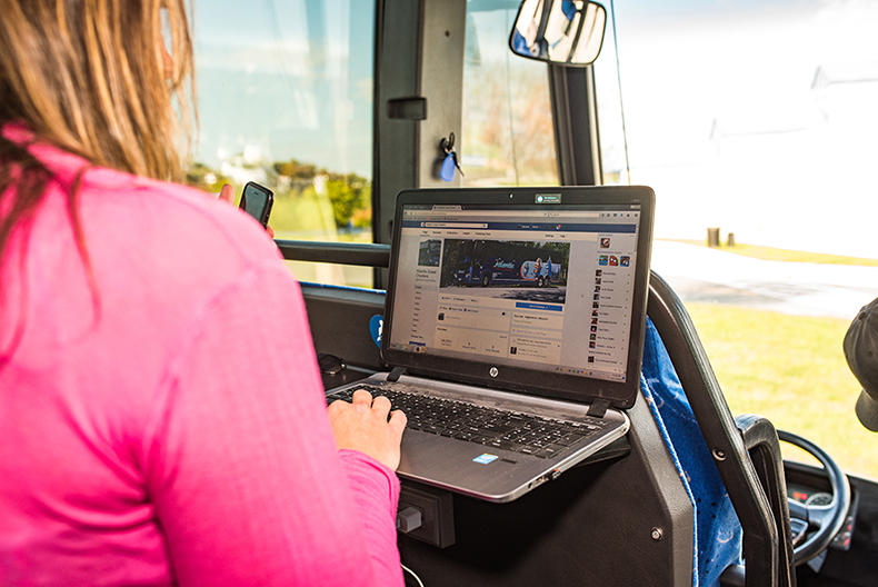 woman using laptop on bus